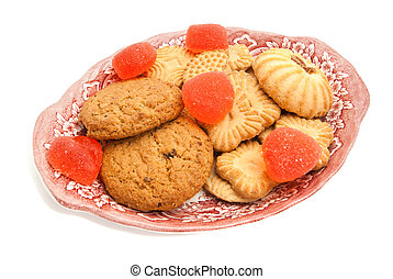 cookies and fruit candy on a plate