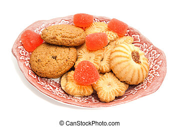 cookies and fruit candy on glass plate