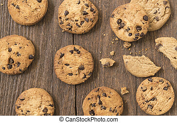 Cookies chocolate or chocolate chips on a wooden table.