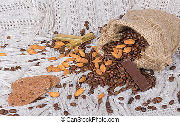 cookies, chocolates, Coffee beans and almonds in canvas sack