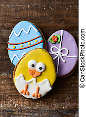 cookies decorated as easter eggs and funny chick