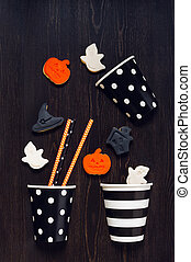 Cookies for Halloween party on the wooden black table