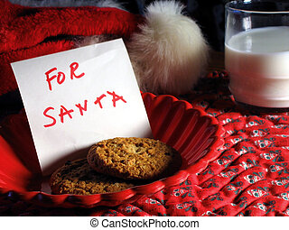 Cookies For Santa - Santa enjoys cookies and milk while...