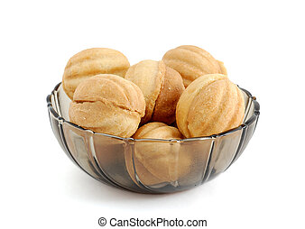 Cookies in bowl isolated on white background