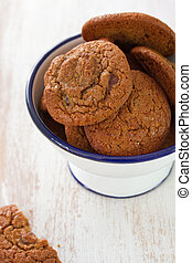 cookies in bowl on white wooden background