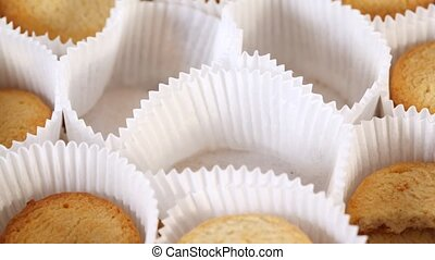 Cookies in paper gradually disappear from tray