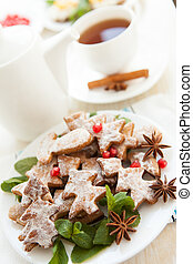 Cookies in the form of Christmas trees and a cup of tea