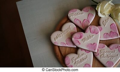 Cookies in the form of hearts. Wedding inscriptions. Pink cookie