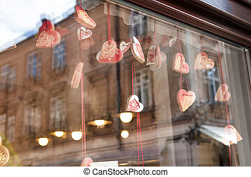 cookies in the shape of a heart hang in the shop