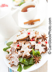 cookies in the shape of Christmas trees and tea