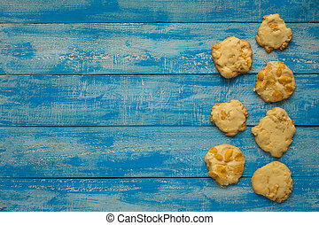Cookies on a blue wooden table with copy space for your text. top view