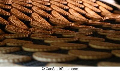 Freshly baked shortbread cookies leave the oven. - Cookies...