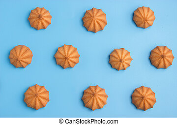 cookies on blue background. Top view.