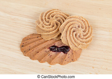 Cookies on wooden table background close up