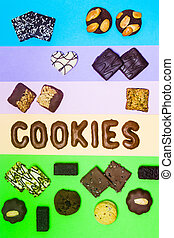 Cookies pastel colored background with various biscuits flat...