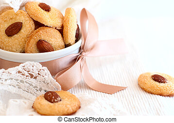 Cookies with almond in the center, dish decorated with...