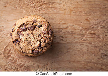 Cookies with chocolate chips on a wooden table. Top view with copy space