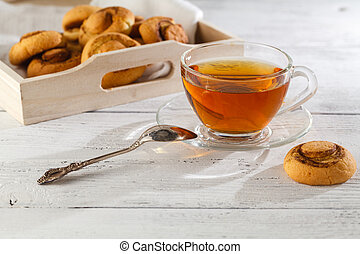 cookies with cinnamon and tea on a table, selective focus, copy space