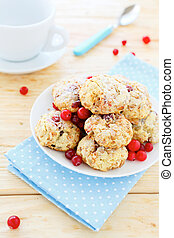cookies with cranberries and a cup of tea