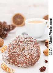 cookies with cup of coffee on white wooden background