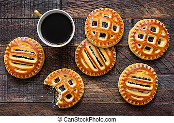 Cookies with jam and cup of coffee