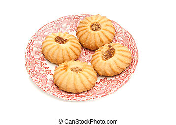 cookies with jam on a dish