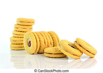cookies with jam on white background