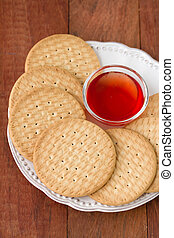 cookies with jam on white plate