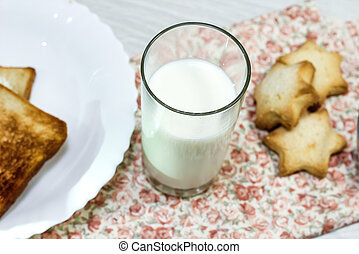 Cookies with milk on the table in the morning. Carbohydrate diet