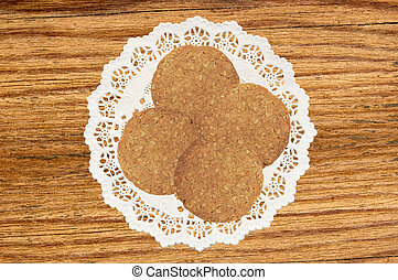cookies with nuts on napkin on wooden background