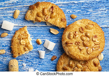 cookies with peanuts on a blue background