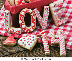 cookies with the word love and the numbers 14 Valentine's Day