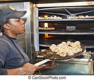 Cooking an Appetizer of Dough Knots - cook at pizza...