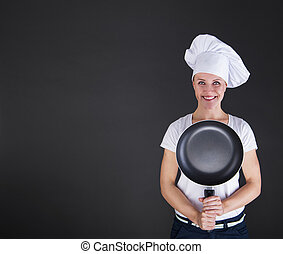 cooking and food concept - smiling female chef, cook or ...