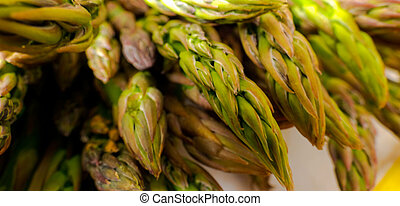 cooking asparagus. Cutting of asparagus cleaning close-up