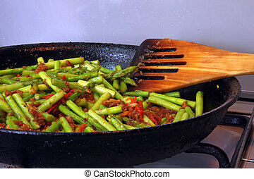 Cooking asparagus - Spicy asian asparagus dish being...