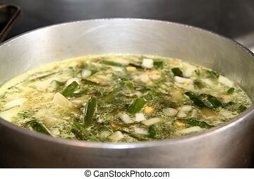 Cooking asparagus soup in a large pot