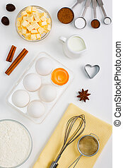 Cooking baking flat lay background with eggs butter kitchen tools
