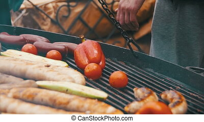Cooking Barbecue Delicious Sausages and Vegetables on the Grill. Slow Motion