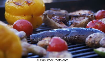 Cooking Barbecue Delicious Sausages, Meat and Vegetables on the Grill. Slow Motion