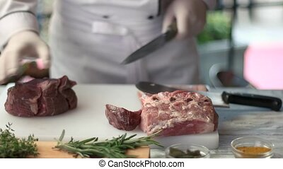 Cooking board with raw meat.