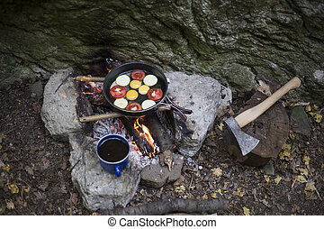 Cooking breakfast at the campsite. - Cooking breakfast on a...