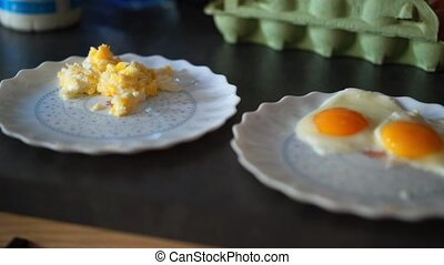Cooking breakfast with fried eggs on the kitchen
