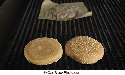 Cooking burgers in a fastfood restaurant. closeup