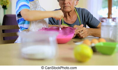 Cooking cake is my passion - Grandmother playing with...