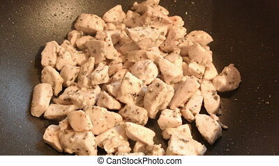 Cooking chicken in a pan