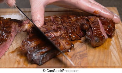 Grilled marinated beef flank steak on wooden board