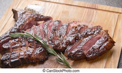 Cooking concept. Grilled marinated beef flank steak on ...