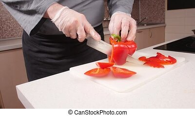 Cooking concept. Young man cuts vegetables in the kitchen