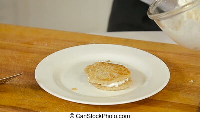 Cooking cottage cheese pancakes - Chef is cooking cottage...